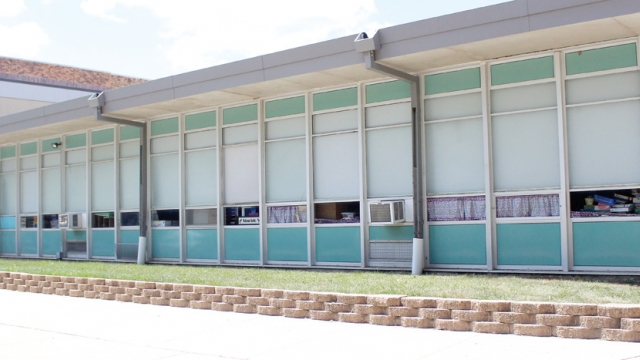 The east-facing windows of the North Iowa School, which have a mid-century design.